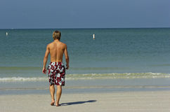 Athletic beach boy. A young muscular male teenager enjoyed the sun and water at americas first beach 2008 in florida Royalty Free Stock Image