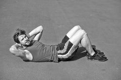 Athletic bearded man with muscular body doing exercises for abdo. Athletic bearded man or sexy handsome guy with muscular body doing exercises for abdominal on Stock Image