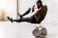 Athletic bearded man performing muscle-building exercises Royalty Free Stock Photo