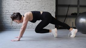 Athletic Beautiful Woman Does Running Plank as Part of Her Cross Fitness, Bodybuilding Gym Training Routine. Side view close up.  stock footage