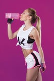 Athletic beautiful young blond woman drinks gainer Stock Photo