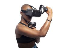 Woman Boxing in VR with a Virtual Reality Headset and Controllers royalty free stock photos