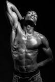 Athletic black man on black background Stock Photography