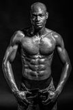 Athletic black man on black background Stock Photo
