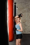 Athletic blond girl in boxing gloves. Stock Images