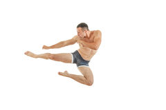 Athletic boxer fighter kicking jumping in the air Royalty Free Stock Photo