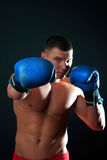 Athletic  boxer during fighting Stock Images
