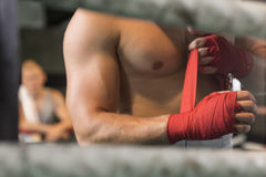 Athletic boxer preparing for fight Royalty Free Stock Photo
