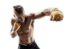 Athletic boxer throwing a fierce and powerful punch. Stock Photos