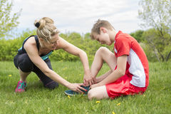 Athletic boy Holding her Painful Injured ankle Stock Photo
