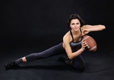 Athletic brunette girl with ball stock images