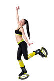 Athletic brunette girl  jumping in a kangoo jumps shoes. Stock Photos