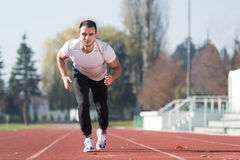 Athletic Build Man Sprinting on the Running Track Royalty Free Stock Image