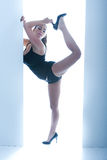 Athletic Busty Woman Posing In Doorway Stock Photos