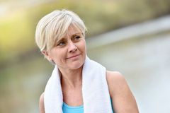 Athletic charming senior lady in jogging outfit Royalty Free Stock Photography