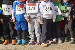 Athletic children ready to start a cross country race. Outdoors. Horizontal Royalty Free Stock Image