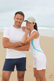Athletic couple on the beach Stock Photo