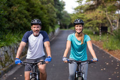 Athletic couple cycling on the open road Royalty Free Stock Photo