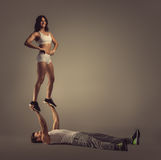 Athletic couple doing acro yoga Royalty Free Stock Images