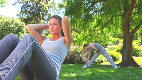 Athletic couple excersising outdoors Stock Photo