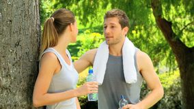 Athletic couple having a drink of water Royalty Free Stock Images