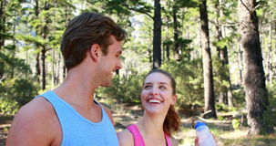Athletic couple on a hike stock footage