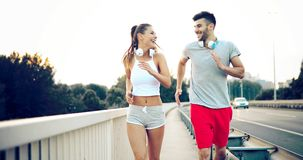 Athletic couple jogging in nature. In good spirit Stock Image