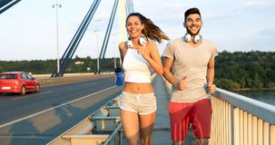 Athletic couple jogging in nature. In good spirit Royalty Free Stock Photography