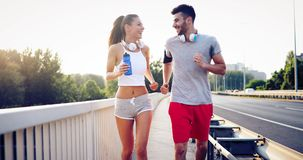 Athletic couple jogging in nature. In good spirit Royalty Free Stock Photo