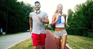Athletic couple jogging in nature. In good spirit Royalty Free Stock Photos