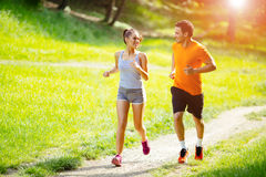 Athletic couple jogging in nature Royalty Free Stock Image