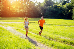 Athletic couple jogging in nature Royalty Free Stock Images