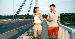Athletic couple jogging in nature. In good spirit Stock Photo