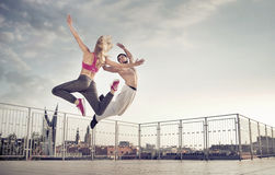 Athletic couple during the jump training. Athletic couple during the hard jump training Royalty Free Stock Photography