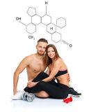 Athletic couple - man and woman after fitness exercise sitting w. Athletic couple - men and women after fitness exercise sitting with dumbbells on the white with stock images