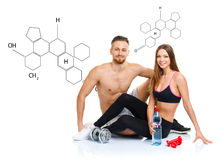 Athletic couple - man and woman after fitness exercise sitting w. Athletic couple - men and women after fitness exercise sitting with dumbbells on the white with royalty free stock photo
