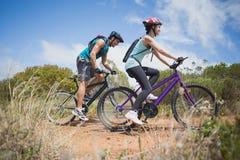Athletic couple mountain biking Stock Image