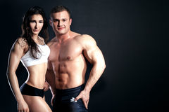 Athletic couple posing. Royalty Free Stock Photos
