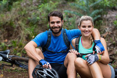 Athletic couple relaxing in forest. Portrait of smiling athletic couple relaxing in forest Stock Images