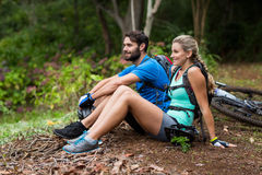 Athletic couple relaxing in forest. Smiling athletic couple relaxing in forest Stock Photos