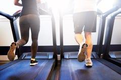 Athletic Couple Running on Treadmill Machine Stock Photography