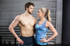 Athletic couple staring into each other in the eyes Stock Image