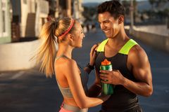 Athletic couple on streets Stock Photos