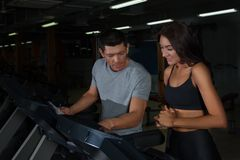 Athletic couple on training in fitness club stock images