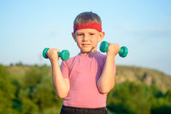 Athletic Cute Boy Lifting Two Small Dumbbells Royalty Free Stock Photo