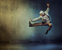 Athletic dancer in a jumping pose Stock Photos