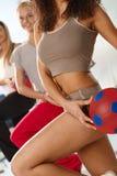 Athletic ethnic body exercising Stock Photo