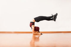 Athletic female dancer arching her back Royalty Free Stock Image