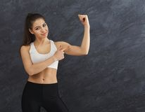 Athletic woman showing muscular body royalty free stock photography