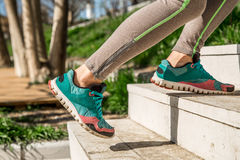 Athletic female legs climb the stairs. Sports, women`s legs go up the stairs ,the concept of sports and sports motivation Stock Image